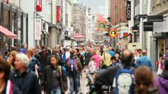 City street overflowed with people with shops Stock Footage