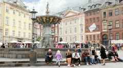 People have rest at fountain on city square Gammeltorv Stock Footage