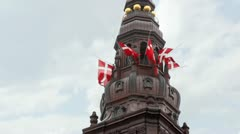 Christiansborg Slot with sculptures and fluttering flags Stock Footage