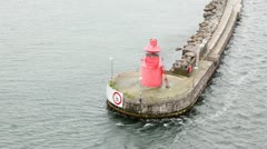 Small beacon standing on platform in middle of water Stock Footage