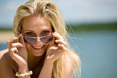 blond woman with sunglasses enjoy sunny day - stock photo