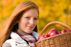 Stock Photo of autumn country - woman with wicker basket