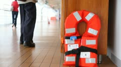 Red life jacket on ship deck close up and man, opening case Stock Footage