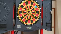 Color target for game in darts and darts flying to it Stock Footage