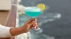 Stock Video Footage of cocktail with straws and in hand lemon against handrail of ship
