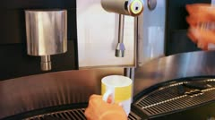 Water being poured in mug from machine by button pressing Stock Footage