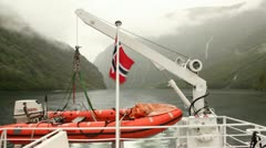 view from stern of vessel floating down fiord on mountain around - stock footage