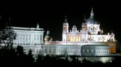 Almudena cathedral is reflected in water at night, time lapse - stock footage