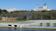 Almudena Cathedral stands near river and fountain, time lapse Stock Footage