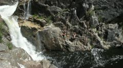 Tilt up waterfall & rock formations at Nethercot Falls, New South Wales - stock footage