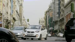 Stream of cars rushes on main street of Madrid - Via Gran Stock Footage