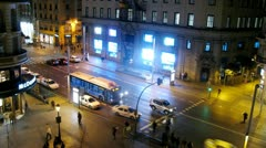 Cars of taxi stand near McDonald cafe at night Stock Footage