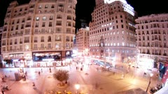 People walk on Gran Via Street and Montera Street in evening Stock Footage
