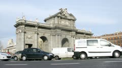 Cars goes near Alcala Gate in Madrid at day Stock Footage