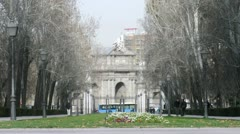 Puerta de Alcala gate stands on square Independence Stock Footage