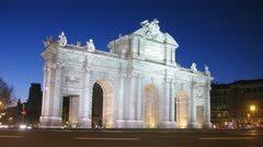 Cars go near Puerta de Alcala gate on square Independence Stock Footage