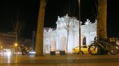 People walk on sidewalk near Puerta de Alcala Stock Footage