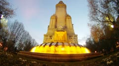 Fountain stands against blue sky at sunset, time lapse Stock Footage