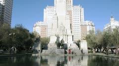 Tourists walk near monument to Miguel de Cervantes Stock Footage