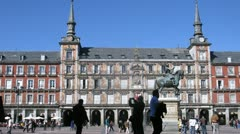 Tourists walk on Plaza Mayor in Madrid at day Stock Footage