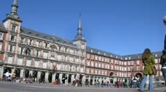 Tourists walk on Plaza Mayor in afternoon Stock Footage