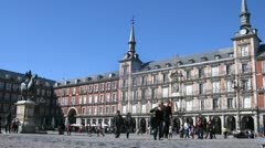 Tourists walk on Plaza Mayor near statue of king Philippe III Stock Footage