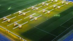 Equipment for illumination of grass stand on field of stadium - stock footage