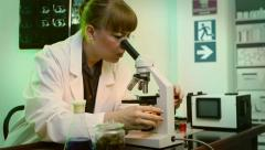 Female Scientist On Microscope (HD) Stock Footage