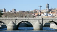 Cars go on bridge Segovia in front of city landscape, time lapse Stock Footage