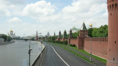 Clouds float on towers of Kremlin and domes of churches Stock Footage