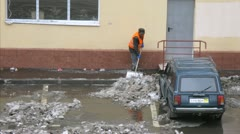 Worker cleans snow on parking in Moscow. - stock footage