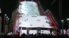 Athletes go down in night on stage of World Cup on snowboard Stock Footage