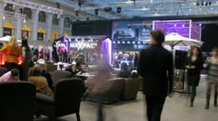 Stock Video Footage of Visitors have rest in bar on VOLVO - Week of fashion