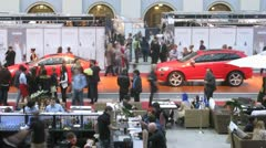 Two red new cars stand at exhibition VOLVO - Week of fashion Stock Footage