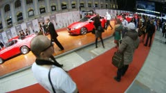 People are photographed with Volvo cars at Week of fashion Stock Footage