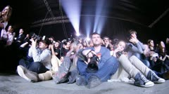 Photographers photograph fashion show on VOLVO - Week of fashion Stock Footage