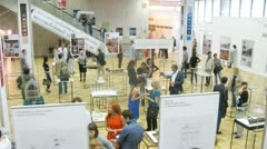 People communicate at exhibition of architecture and design Stock Footage