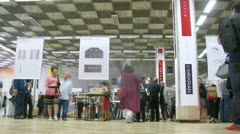 Stock Video Footage of People consider models at exhibition of architecture and design