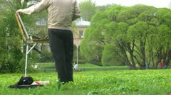 Painter draw picture in Botanical garden Stock Footage