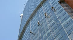 Workers of special company clean skyscraper windows Stock Footage