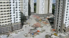 Trucks bring construction materials on building site Stock Footage