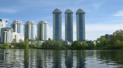 Housing estate Vorobyovy Gorystands on bank of lake Stock Footage