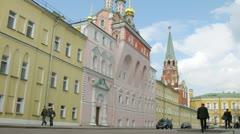 People go on road in afternoon near old buildings of Kremlin Stock Footage