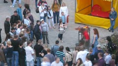 People stand near attraction in cultural entertainment complex Stock Footage