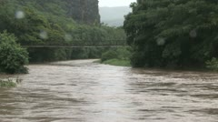Waimea River Flood with Swinging Bridge Stock Footage