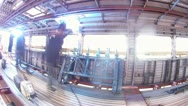 Workers weld details in wagon at engineering plant, time lapse Stock Footage
