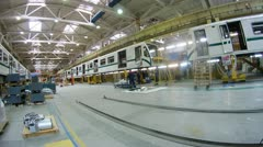 Workers carry out assembly of new carriages in plant workshop Stock Footage