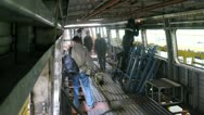 Workers weld iron walls in wagon at engineering plant Stock Footage
