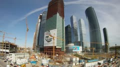 Cars go near building Moscow City business center in afternoon - stock footage
