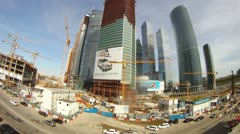 Cranes stand on building of Moscow City business center Stock Footage